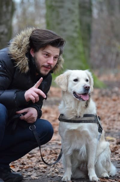 guy and his dog spending time in nature